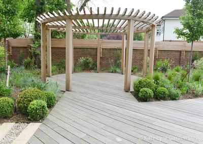 Large wrap-around garden design in Ullathorne Road, Streatham, 3