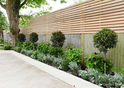 Large wrap-around garden design in Ullathorne Road, Streatham, 9