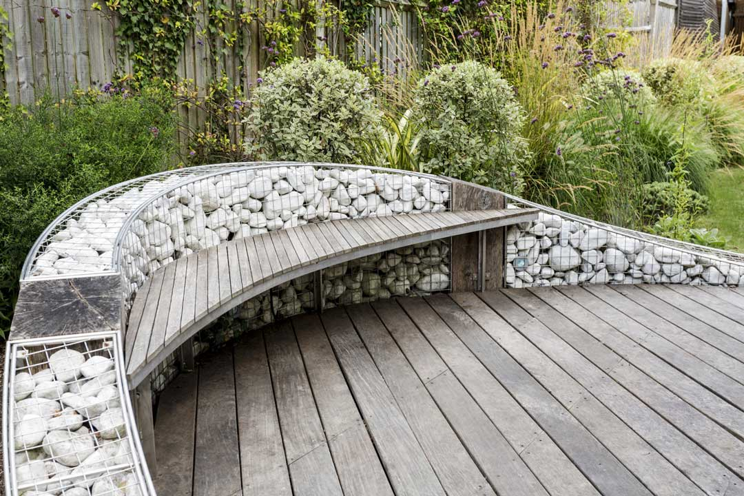 Hanging bench on gabion wall