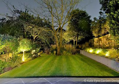 Large back garden design in Crystal Palace, South London, 10: evening view