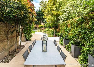 Outdoor dining area in garden design in Alleyn Road, Dulwich