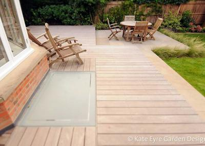 Medium back garden design in Wimbledon, 1