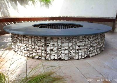 Gabion fire-pit in a garden design in Crystal Palace, London